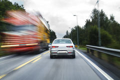 Zoooming traffic. Traffic on E18 in Norway north of the small  Norwegian town Kragerø in august 2011 Royalty Free Stock Image
