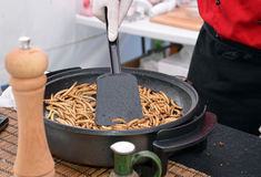 Zophobas morio larvae food frying on the pan Stock Photo