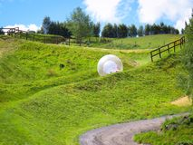 Zorb rolling downhill in Queenstown New Zealand stock photos