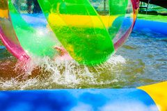 Zorbing in a small pool Royalty Free Stock Images