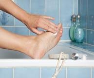 Zorg voor voeten Stock Foto