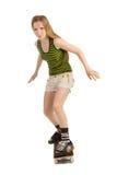 Zorgvuldig meisje op het skateboard Royalty-vrije Stock Foto's