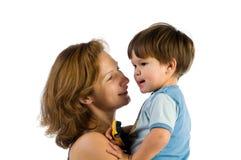 Zorgvuldige moeder met kind Stock Fotografie