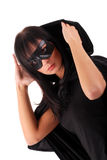 Zorro girl. Young woman dressed as zorro, in black mask, coat and hood Royalty Free Stock Photo