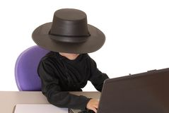 Zorro Help Desk 2. Child as costumed Zorro at laptop helpdesk Stock Photo