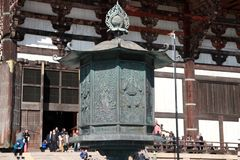 Metal lamp in front of buddhist church made from teak wood the biggest of the world of Todaiji temple. stock photography