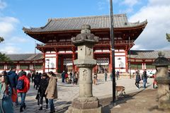 Stone lantern in front of the second antique wooden archway entrance of Todaiji temple. Zoshicho, Nara, Japan, November 21, 2017 : Stone lantern in front of the royalty free stock photos