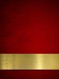 Złota talerz lub plakieta na czerwonym tle Obraz Royalty Free