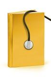 Złoto książka medyczny - ścinek ścieżka Zdjęcia Royalty Free