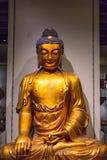 Złoty Buddha ścianą Fotografia Royalty Free