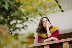 Zrelaksowany zadumany kobiety outside dom na jesieni Obrazy Royalty Free