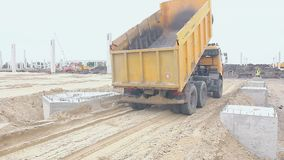 Zrenjanin, Vojvodina, Serbia - May 21, 2015: Dump truck is unloading soil. Dumper truck is unloading soil or sand at construction site stock video
