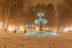 Zrinjevac park Fountain decorated by Christmas lights as part of Advent in Zagreb. Stock Photos