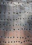 Zrudziała metal tekstura z dziurami fotografia stock