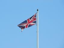 Zrzeszeniowej dźwigarki flaga przeciw jasnemu niebieskiemu niebu Zdjęcia Stock