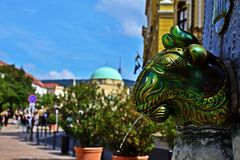 Zsolnay Fountain in Pécs, Hungary. Zsolnay Founatin in Pécs with the medieval mosque in the background stock image