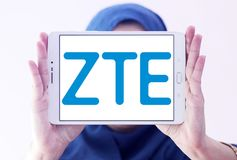 ZTE Corporation logo. Logo of ZTE Corporation on samsung tablet holded by arab muslim woman. ZTE, is a Chinese multinational telecommunications equipment and Royalty Free Stock Photography