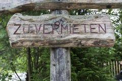 Zu vermieten. A wooden For Rent sign in german language, saying: zu vermieten Stock Image