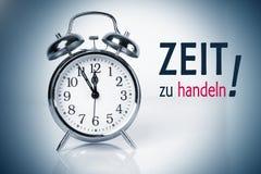 Zu Zeit handlen (время для действия) Стоковое Изображение
