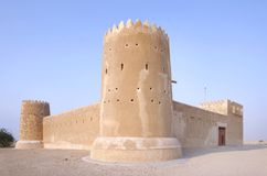 Zubarah fort Qatar, a view from south. The Zubarah Fort built in 1938 follows a traditional concept with a square ground plan with towers at the corner Stock Images