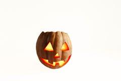 Zucca allegra di Halloween isolata su un fondo bianco con la a Immagini Stock
