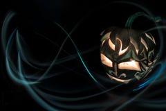 Zucca di Halloween con la candela dentro Immagine Stock Libera da Diritti