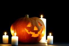 Zucca di Halloween con le candele Fotografie Stock