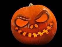 Zucca di Halloween, fronte spaventoso isolato su fondo nero fotografia stock