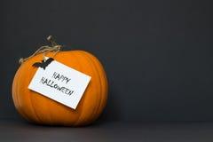 Zucca di Halloween su una priorità bassa nera Fotografie Stock