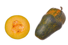 Zucca e una fetta di zucca isolata su fondo bianco Fotografia Stock