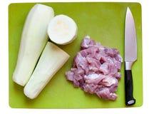 Zucche, carne, coltello su un tagliere Fotografia Stock Libera da Diritti