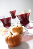 Zucche con vetro rosso Fotografie Stock
