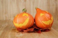 Zucche di Halloween con il fronte divertente Fotografie Stock