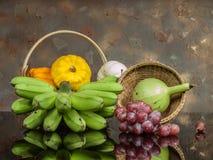 Zucche e banana ed uva Fotografia Stock