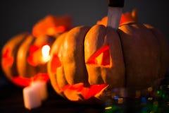 Zucche spaventose di Halloween con i fronti Immagini Stock Libere da Diritti