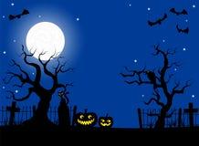 Zucche in una notte della luna piena al cimitero Fotografia Stock