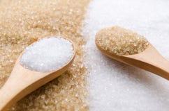 Zucchero bianco e marrone Immagine Stock