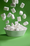 Zucchero che cade Fotografie Stock