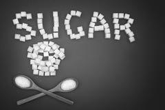 Zucchero di parola e cranio dello zucchero immagini stock