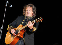 Zucchero Fornaciari. A portrait of famous italian singer Zucchero Sugar Fornaciari playin guitar during a concert Royalty Free Stock Photography