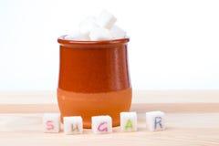 Zucchero nella tazza Immagini Stock