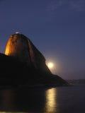 Zucchero-pagnotta alla notte - immagine verticale Fotografie Stock