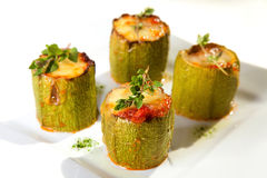 Zucchini. Baked zucchini stuffed with bacon, tomatoes and mozzarella Stock Images