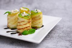 Free Zucchini Appetizer Rolls With Cream Cheese And Basil On White Plate On Gray Background. Fried Vegetable Marrow Sushi Rolls. Stock Photography - 203515612