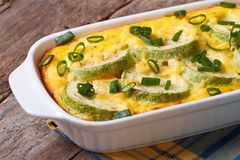 Zucchini baked with cheese, eggs and onion closeup Royalty Free Stock Photo