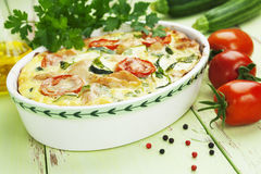 Zucchini baked with chicken, cherry tomatoes and herbs Stock Photo