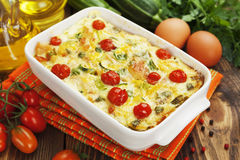 Zucchini baked with chicken, cherry tomatoes and herbs Royalty Free Stock Photos