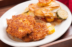 zucchini baked with crispy pork cutlet Stock Images
