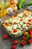Zucchini baked i with chicken, cherry tomatoes and herbs Stock Photos