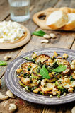Zucchini Basil mint cashews salad with ricotta and fresh bread Royalty Free Stock Image